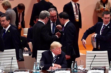 trump alone at G20