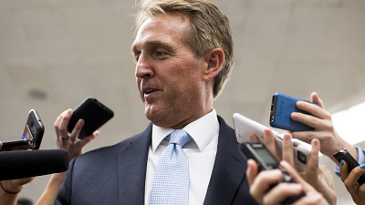 jeff-flake-with-reporters