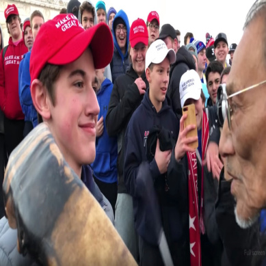 maga hat teen smirking native elder vet
